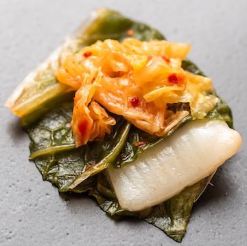 BlueNalu's whole-muscle, cell-based yellowtail prepared in acidified form in a kimchi recipe (Photo: Business Wire)