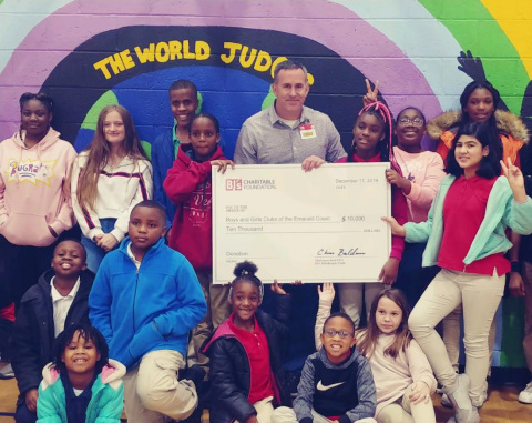 Tom Condon, General Manager, BJ's Wholesale Club in Pensacola, Florida (center) presents a $10,000 donation from the BJ's Charitable Foundation to the Boys and Girls Clubs of the Emerald Coast on Dec. 17, 2019. (Photo: Business Wire)
