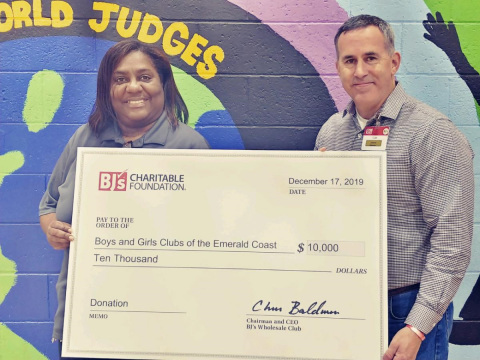 Tom Condon, general manager, BJ's Wholesale Club in Pensacola, Florida (right), presents a $10,000 donation from the BJ's Charitable Foundation to Tanya Richardson, program director, Boys & Girls Clubs of the Emerald Coast on Dec. 17, 2019.(Photo: Business Wire)