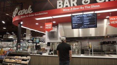 Earth Fare Charlotte Cafe with digital menu board, provided and installed by Mood Media. (Photo: Business Wire)