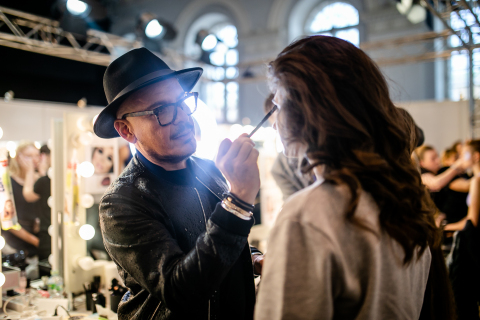 MBFW Russia, Luis Casco prepping runway model (Photo: Mary Kay Inc.)