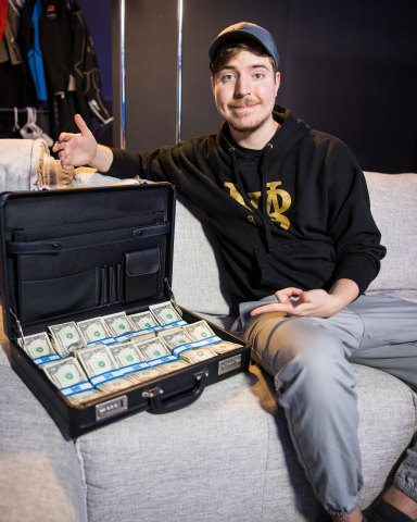 MrBeast poses with $1 million in cash (Photo: Business Wire)