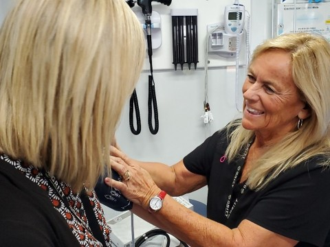 Joyce McCormick, Medical Review Nurse, performs a blood pressure check for Tara McDuffie (Photo: Business Wire)