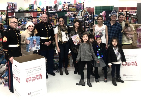 TransPerfect family members and our new Marine Corps friends pose with a few of the 2,300 toys purchased. (Photo: Business Wire)