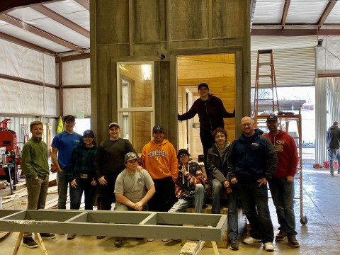 Brett Joerger, CEO of Westhaven Inc. with 4G Foundation and local students, building a Tiny House for Camp Fire survivor, Chris Brackett. (Photo: Business Wire)