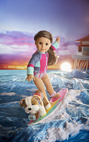 Surfer Joss Kendrick, American Girl's 2020 Girl of the Year, riding the waves with her bulldog, Murph. (Photo: Business Wire)