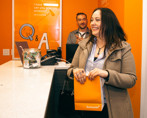 Sunnyside* Customer Jacqueline Ryan Makes the First Legal Purchase of Recreational Cannabis in Illinois at the Company's Lakeview Dispensary (Photo: Business Wire)