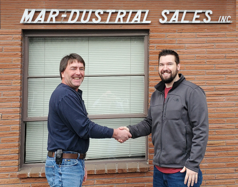 Drew Hansen (left), general manager of Mar-Dustrial Sales, and Joshua Hopkins, president of In Stock Parts, seal the deal. (Photo: Business Wire)