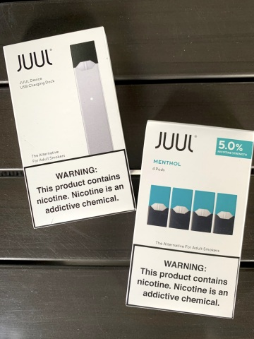 A JUUL device and menthol flavor. (Photo: Business Wire)