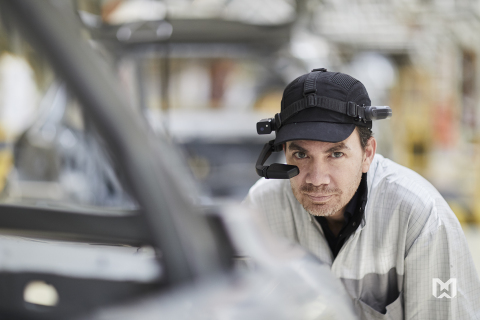 Factory employees at Groupe PSA wear RealWear's assisted reality headsets (HMT-1s) to improve factory uptime and empower and connect workers with other experts. Headsets are versatile and serve multiple use cases to maintain quality and safety in assembly of automobiles. The auto conglomerate has already logged thousands of hours using RealWear's voice-controlled, hands-free Android system. (Photo: Business Wire)