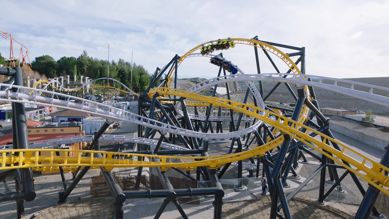 The new West Coast Racers roller coaster debuted at Six Flags Magic Mountain and features side-by -side racing and sleek trains designed by world famous West Coast Customs, the premier vehicle modification shop. The coaster features four magnetic launches, four total inversions, 14 track crossovers, side-by-side airtime hills and overbanked turns, plus a high five.