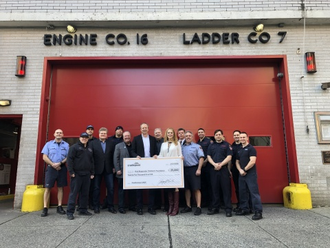 Cradlepoint CEO George Mulhern presents a check of $25,000 to the First Responders Children's Foundation on January 15, 2020. (Photo: Business Wire)