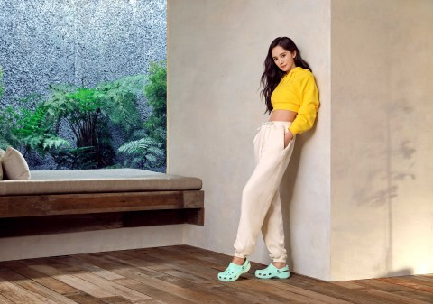 """Renowned Chinese actress Yang Mi wearing her Classic Clogs in new Neo Mint. Yang Mi is one of five global ambassadors announced as part of Crocs' newest """"Come As You Are"""" campaign, inspiring fans to feel comfortable in their own shoes. (Photo: Business Wire)"""