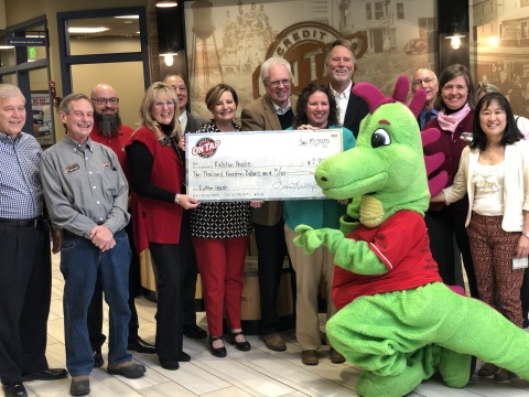 On Tap Credit Union Board Members and Employees on the left and on the right side Ralston House Board Members and Employees celebrating the end of the Holiday Giving campaign with a check presentation at On Tap Credit Union in Olde Town Arvada. (Photo: Business Wire)