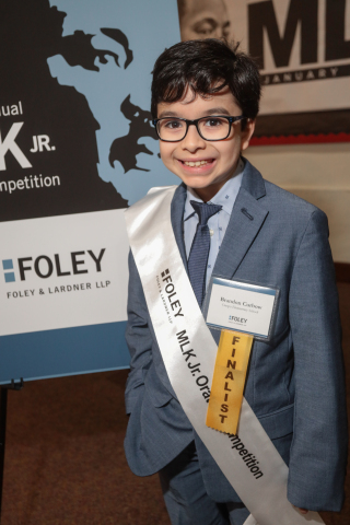 "Brandon Curbow, a fourth-grade student from Crespo Elementary School in Houston, won first place in the 24th Annual Foley & Lardner MLK Jr. Oratory Competition, held Jan. 17, 2020 at Antioch Missionary Baptist Church. His speech stressed Dr. King's vision to ""make America SAFE again."" (Photo Credit: Katy Anderson)"