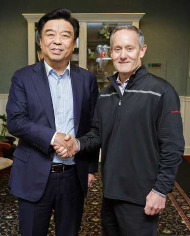 Pictured: Shandong Ruyi Chairman, Yafu Qiu and The LYCRA Company CEO, Dave Trerotola (Photo: Business Wire)