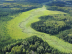 A lush green wetland complex in Manitoba is part of Forest Management License Area #3 (Swan Valley) managed by LP. Wetlands like these are incorporated into forest management planning. DUC and LP work together to find ways to continue operating in the boreal forest while helping conserve wetlands and waterfowl. ©DUC