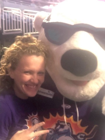 Major Central Florida economic driver Silver Airways partners with Orlando Solar Bears - Silver Airways Senior Manager of Alliances and Business Development Katie Loughlin with Orlando Solar Bears Official Mascot Shades (Photo: Business Wire)