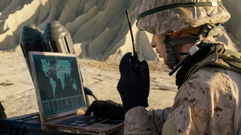 BAE Systems will provide C5ISR, technical support, and life cycle sustainment to the U.S. Navy to improve the situational awareness of military operators and decision makers. Pictured here is a soldier using a laptop and radio communications during a military operation in the desert. Credit: gorodenkoff.