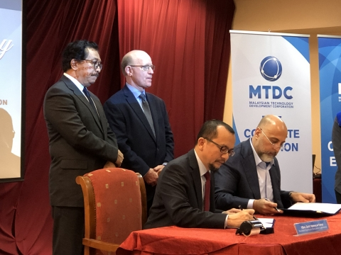 MTDC and WLC execute MoU to deploy Digital Economy Platform with world's leading technology firms digitizing Malaysia and its trade partners. (Photo: Business Wire)