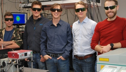 Researchers from Lund University developed an imaging method that provides an unprecedented view of sprays such as the ones used for liquid fuel combustion. Pictured (from the left) are PhD student Kristoffer Svendsen, postdoctoral researcher Diego Guénot, group leader at the Division of Combustion Physics Edouard Berrocal, group leader at the Division of Atomic Physics Olle Lundh and PhD student Jonas Björklund Svensson. Credit: Edouard Berrocal, Lund University