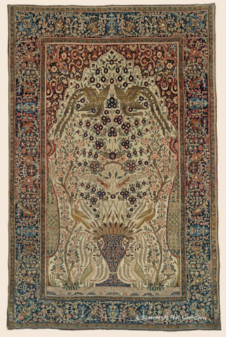 """Antique Persian Mohtasham Kashan """"Vase Rug"""", 4'5"""" x 6'8"""", 3rd quarter, 19th century. Epitomizing the majesty and refinement that make the finest 19th century carpets from this Central Persian city is this tour-de-force reinvention of the classic Vase and Tree of Life format. Note its three pairs of mythical birds, culminating in a pair of entirely singular birds-of-paradise. (Photo: Business Wire)"""
