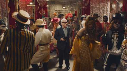 "Martin Scorsese stands alone in the middle of a costume party, sans a costume anxiously awaiting an answer from Jonah Hill - will he ""show up?""  (Photo: Business Wire)"