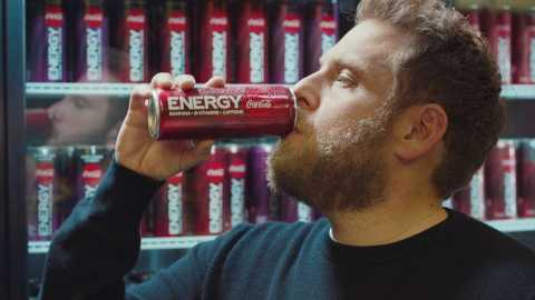 "Jonah Hill drinks a Coca-Cola Energy to give him the energy he needs to ""show up"" to the party with Martin Scorsese. (Photo: Business Wire)"