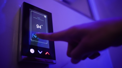 A guest uses a touch pad to set the shower temperature at The Sinclair hotel. Intel and The Sinclair, Autograph Collection, in Fort Worth, Texas, announced in February 2020 a collaboration to deliver a next-generation connected guest experience. (Credit: Sinclair Holdings LLC)