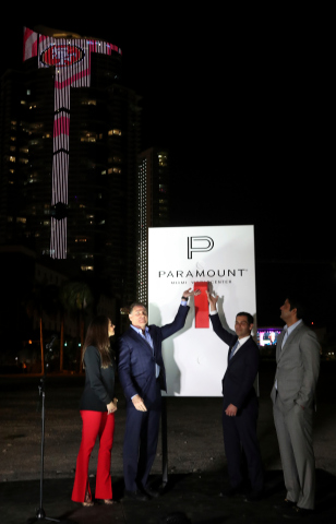 Miami Mayor Francis Suarez (right) CEO-Developer Daniel Kodsi (left) flip giant switch at Paramount Miami Worldcenter Super Bowl countdown and tower lighting ceremony on January 29, 2020. Mayor and CEO are flanked by (right) Miami Worldcenter Managing Principal Nitin Motwani and (left) OneWorld Properties CEO Peggy Olin. (AP Images for World Satellite Television News)