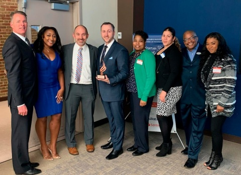 The Fulton Bank team was proud to accept the first Community Revitalization Award (CRA) from the Affordable Housing Centers of Pennsylvania (AHCOPA) for originating the most CRA mortgage loans in partnership with AHCOPA in the Philadelphia Region. Pictured (from left) are: Eric Seestedt, regional mortgage manager; Sahaad Washington, mortgage loan officer; Ken Bigos, executive director of AHCOPA; Jeff Vilk, CRA mortgage sales manager; Chante Meares, CRA mortgage loan officer; Monica Gonzalez, CRA mortgage loan officer; Julius Sharpe, CRA mortgage loan officer; Predeitha Oliver, Operation HOPE financial well-being coach. (Photo: Business Wire)