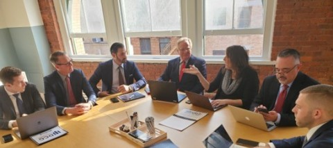 Dave Cantin and his team meet with dealer principals to finalize the terms of a deal. (Photo: Business Wire)