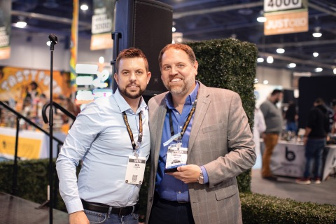 """Brian Moyer, CEO of Criticality, LLC (right) accepts """"Best CBD Topical"""" award from Ben Stimpson of The Hemp Business Magazine (Photo: Business Wire)"""