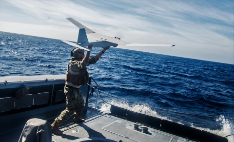 A sailor launches AeroVironment's Puma All-Environment (AE) unmanned aircraft system at sea. U.S. Navy photo by Chief Boatswain's Mate Nelson Doromal Jr.