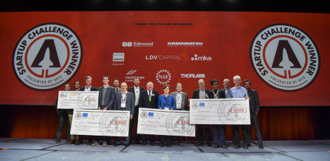 PITCH PERFECT FOUNDERS: Odin Technologies' Steven Hansen, 4th from left, Eysz' Rachel Kuperman, 7th from right, and Rubitection's Sanna Gaspard, 4th from right, display their winning checks with team members, sponsors, judges, and SPIE President John Greivenkamp, center. (Photo: Business Wire)