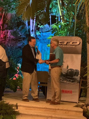 Duane Kuck, CEO, Regal Boats, accepts 2020 Yamaha Marine Industry Champion Award from Ben Speciale, Yamaha Marine U.S. Business Unit President (Photo: Business Wire)