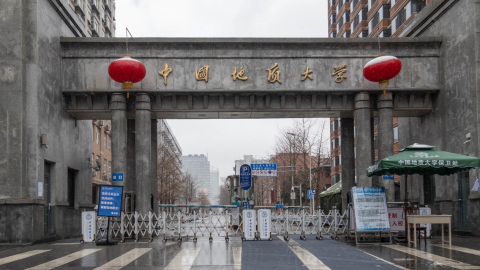 Closed school gate of China University of Geosciences, Beijing, China, February 14, 2020. /CGTN Photo by Qu Bo