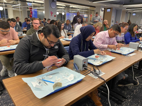 More than 50 dentists who provide care in Aspen Dental-branded practices attend a two-day dental implant training program at ADMI's Chicago-based Practice Support Center (PSC) in advance of the rollout of dental implant therapy as a treatment option. Located at 1040 W. Randolph in Chicago's Fulton Market District, the PSC opened in 2018 and is the organization's hub for learning and development and other support functions. (Photo: Business Wire)