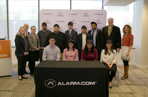 Representatives of Alarm.com, the Office of Governor Northam, Northern Virginia Community College and Fairfax County Economic Development Authority stand with the first apprentices to join the new Alarm.com Apprenticeship program. (Photo: Business Wire)
