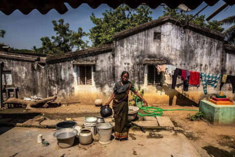 Mrs. Gurujalli Tejavathi outside her home in the Bhadradri District in India. Mrs. Tejavathi receives free eye care for a previously transplanted cornea from the Tej Kohli Foundation. (Photo: Business Wire)