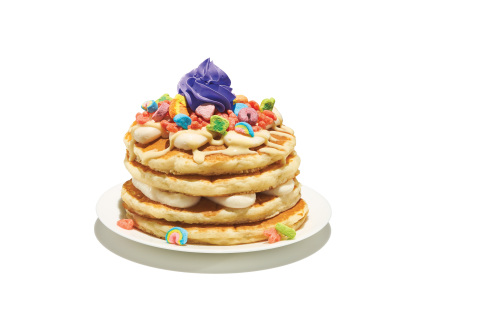 Fruity Lucky Charms™ Pancakes are buttermilk pancakes topped with cereal milk mousse, vanilla sauce, Fruity Lucky Charms™ cereal and a crown of sweet purple whipped icing. (Photo: Business Wire)