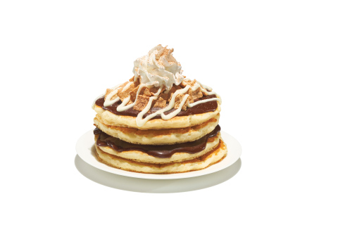 Cinnamon Toast Crunch™ Pancakes are buttermilk pancakes topped with cinnamon spread, Cinnamon Toast Crunch™ cereal, cream cheese icing, a crown of whipped topping and cinnamon sugar. (Photo: Business Wire)