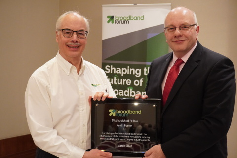 Broadband Forum President Tom Starr presents Kevin Foster with his Distinguished Fellow Award (Photo: Business Wire)