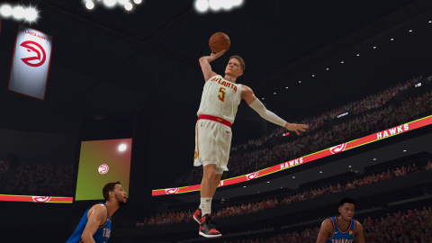 In-game NBA 2K20 screenshot of Make-A-Wish kid William Floyd dunking in an Atlanta Hawks jersey. (Photo: Business Wire)