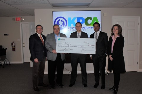 """Molina Healthcare presents $100,000 donation to support Kentucky Primary Care Association's """"Connecting Kids to Coverage"""" program. From left to right, Michael Easterday of Molina Healthcare; David Bolt, chief operating officer of Kentucky Primary Care Association; Jack Miniard, Clover Fork Clinic; Dwayne Sansone of Molina Healthcare and Rachael FitzGerald, chief development officer of Kentucky Primary Care Association. (Photo: Business Wire)"""