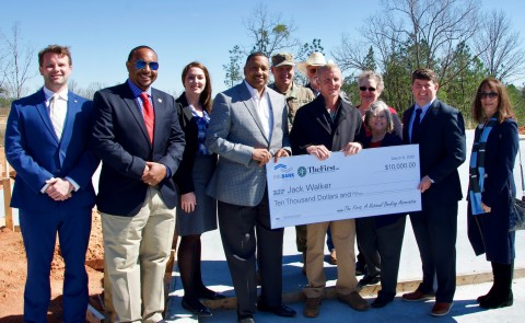 U.S. Representative Steven Palazzo, R-MS, joined Federal Home Loan Bank of Dallas and The First, A National Banking Association at a check presentation to help fund the construction of a new residence for Jack Walker, a recipient of the HAVEN Program and disabled Purple Heart recipient and veteran. (Photo: Business Wire)