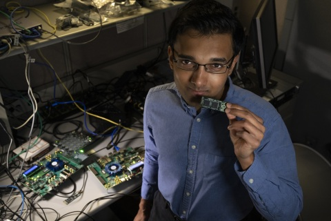 Intel Labs' Nabil Imam holds a Loihi neuromorphic test chip in his Santa Clara, California, neuromorphic computing lab. He and a research team from Cornell University are building mathematical algorithms on computer chips that mimic what happens in your brain's neural network when you smell something. (Credit: Walden Kirsch/Intel Corporation)