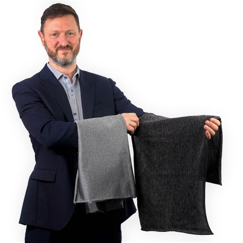 PPSS Group's CEO showcasing first production sample of his firm's black Cut-Tex PRO cut resistant fabric (Photo: Business Wire)