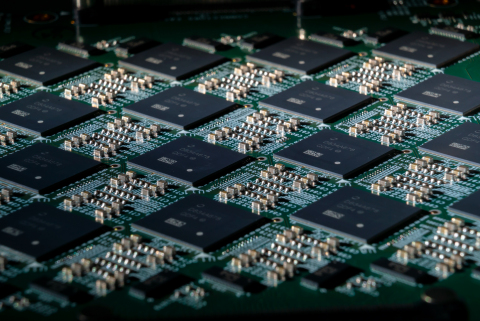 A close-up shows an Intel Nahuku board, each of which contains eight to 32 Intel Loihi neuromorphic research chips. Intel's latest neuromorphic computing system, Pohoiki Springs, was unveiled in March 2020. It is made up of 24 Nahuku boards with 32 chips each, integrating a total of 768 Loihi chips. (Credit: Tim Herman/Intel Corporation)
