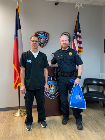 On Wednesday, Steven C. Hoffart, PharmD, owner and operator of Magnolia Pharmacy in Magnolia, Texas, compounded, donated and delivered pharmaceutical-grade, alcohol-based hand sanitizers to Magnolia Police Department Chief of Police Kyle Montgomery to help curb the coronavirus spread among first responders. (Photo: Business Wire)